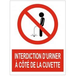 Panneau interdiction d'uriner à côté de la cuvette